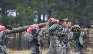 Army Special Forces candidates carry a log during a recent Special Forces Assessment and Selection class at Camp Mackall at Fort Bragg, North Carolina. Two female officers have qualified to undergo training to become Green Berets. Photo courtesy of the U.S. Army