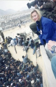 Crowds can quickly turn into riots. CNN correspondent Alex Quade covering Kabul, Afghanistan 2001/2002.  Photo: Courtesy CNN