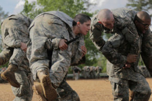 Then-Army 1st Lt. Kirsten Griest (C) and fellow soldiers participate in combatives training during the Ranger Course on Fort Benning, Ga., in April 2016.