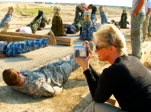 "War reporter Alex Quade covers Medic Tim's ""motivation exercise"" with his Iraqi Foreign Internal Defense (FID) force. (Photo courtesy of Alex Quade)"
