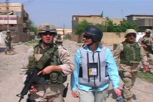 CNN correspondent Alex Quade covering U.S. soldiers in Iraq. Body armor: vest, helmet and anti-ballistic eyewear protection are essential, as well as being aware of your surroundings. Photo: Courtesy CNN